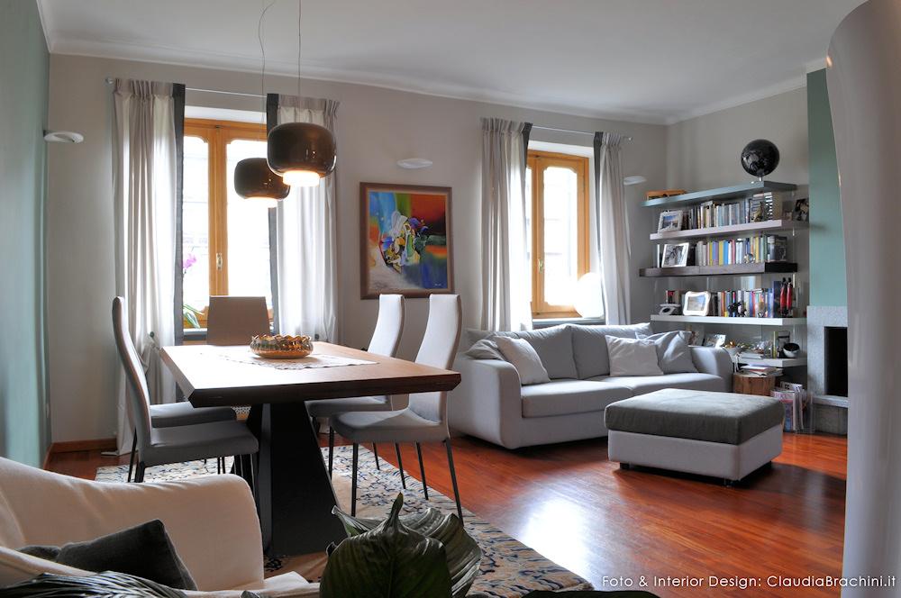 soggiorno con parete verde e elementi naturali claudia