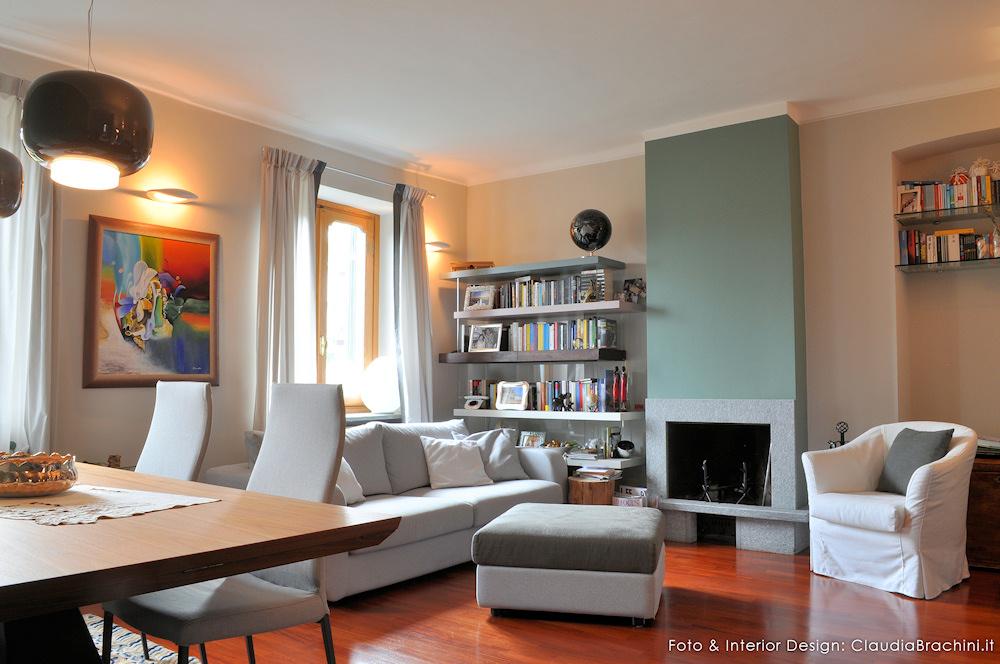 Soggiorno con parete verde e elementi naturali claudia for Lago soggiorno
