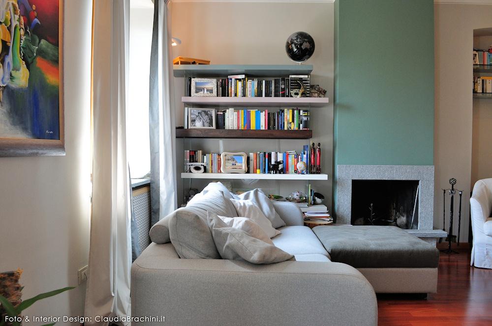 Soggiorno con parete verde e elementi naturali claudia for Soggiorno con divano