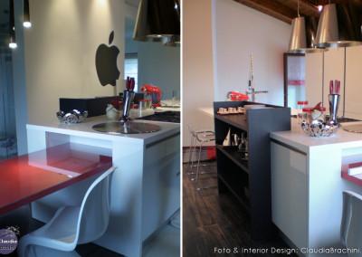 cucina con isola e libreria