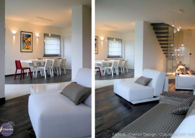 soggiorno arredi bianchi e sedia rossa