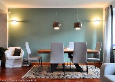 zona pranzo parete verde tavolo Cattelan Eliot